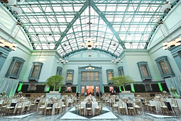 Harold Washington Library wedding reception skylight neutral decor blue runner gold details gay lgbt