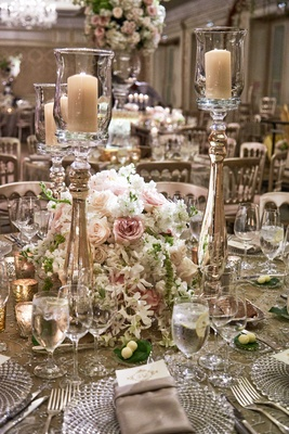 White, pink rose wedding centerpiece with tall candleholder, cut crystal charger plates