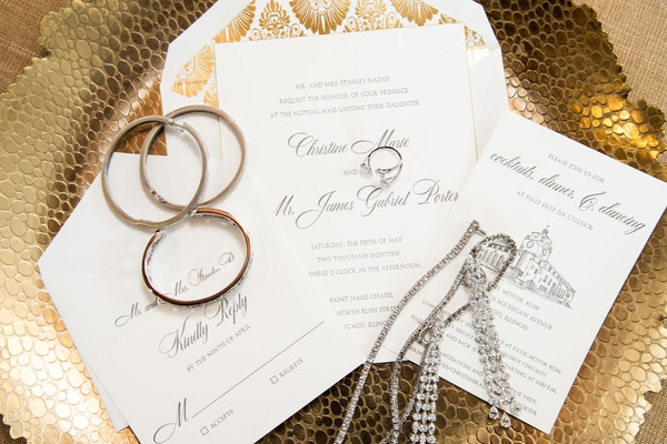 white gold grey invitation suite with drawing of reception venue gold art deco style envelope liner