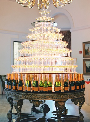 wedding reception cocktail hour tower of champagne coupe glasses Veuve Clicquot bottles
