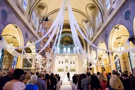 catholic church wedding ceremony with white drapery