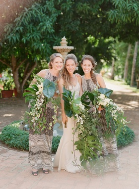Bride with sisters braids cascading palm frond unique bouquets wedding ideas sequin bridesmaid dress