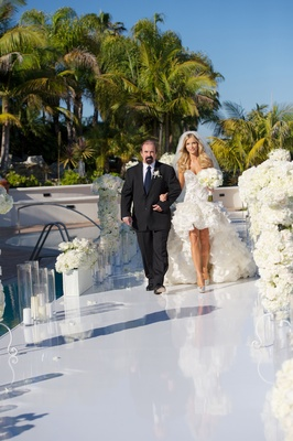 Joanna Krupa walking down aisle with her father at ceremony