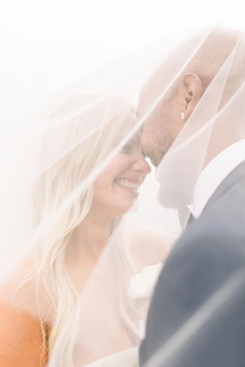 wedding photo bride and groom under bridal veil shane vereen and taylour rutledge