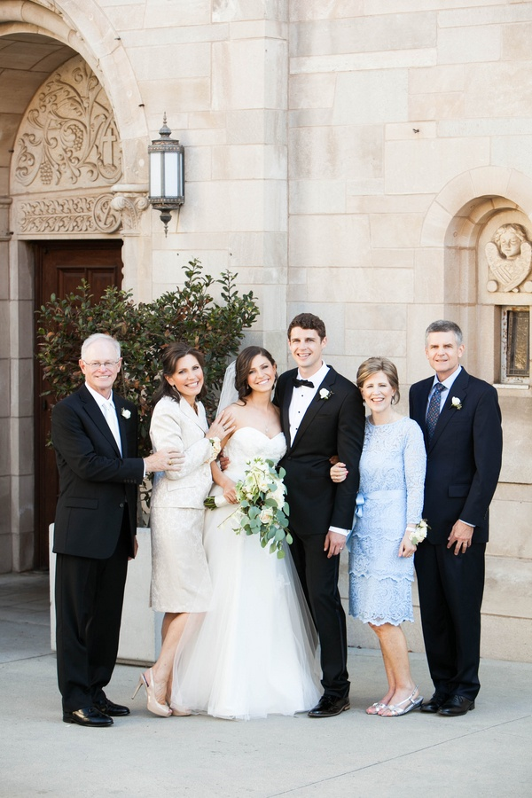 bride and groom with parents respectively at St. Monica church in Santa Monica