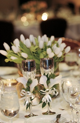 White table linens and centerpiece with silver goblets