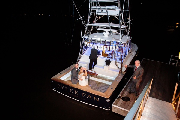 bride and groom leave reception on boat