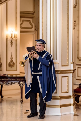 wedding ceremony entertainment man playing trumpet in royal wedding attire classic entertainment