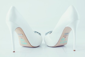 Bridal white Badgley Mischka stilettos with her new married name on sole and wedding date