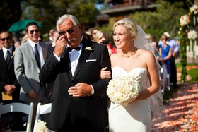 Dad walking bride down the aisle and crying