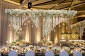 wedding reception long mirror table with tall riser overhead centerpiece candle orb orchids flowers