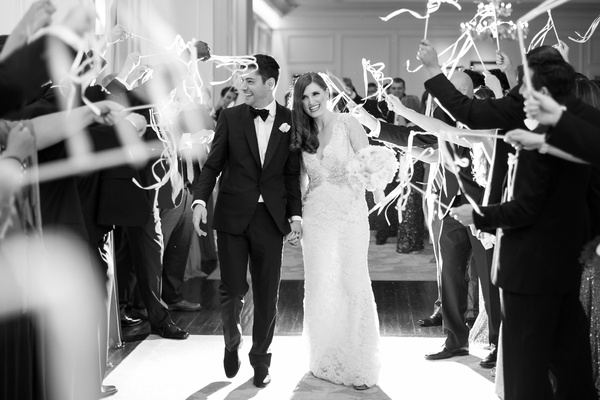 black and white photo of grand exit with streamer wands being waved