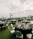 rooftop wedding reception, grey chairs with gold, bistro lights, astroturf