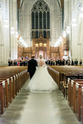 Bride walks down aisle with father of bride at Duke University