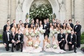 wedding party in front of church arch pink bridesmaid dresses groomsmen in black white suits bow tie