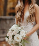 Suzanna Villarreal and Alex Wood LA Dodgers wedding bouquet with white flowers ferns garden rose