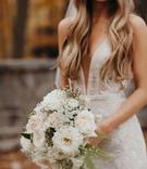 Suzanna Villarreal and Alex Wood LA Dodgers wedding bouquet with white flowers ferns garden rose