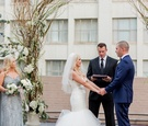bride in blush by hayley paige, groom in navy tuxedo, friend officiating wedding