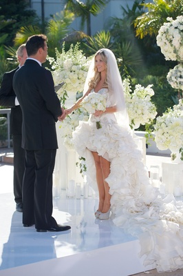 Joanna Krupa in ruffle gown at California wedding ceremony