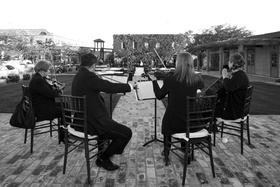 Black and white photo of wedding string quartet