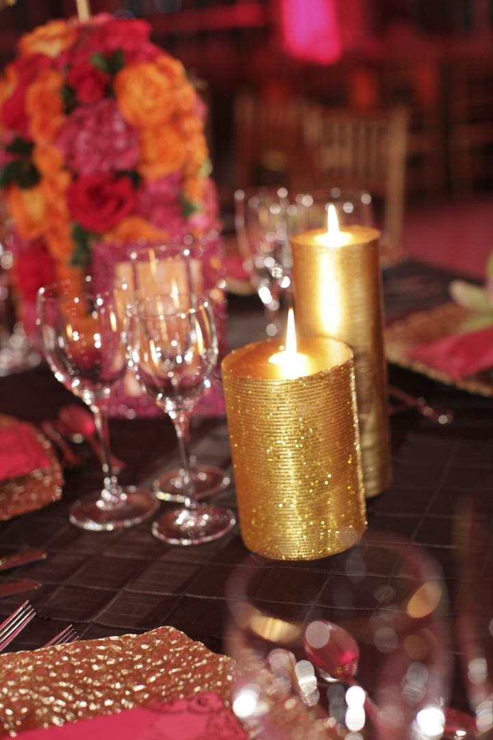 Orange and pink flowers and golden glitter candle