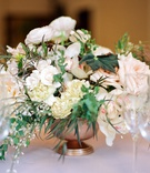 small textured centerpieces with variety of ivory florals and greenery