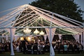 outdoor wedding reception with open air tent with roof of twinkling lights