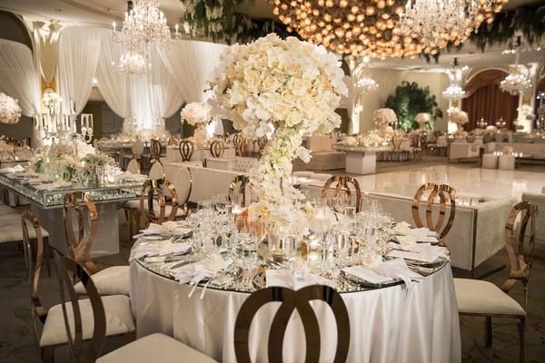 wedding reception white rose gold round table mirror top dance floor chandelier beverly hills hotel
