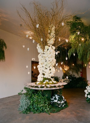 Table with greenery base and suspended votives