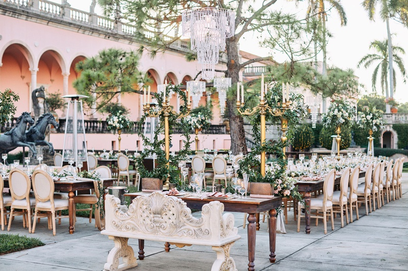 ringling museum wedding reception with gold candelabra and lots of greenery, courtyard with statues