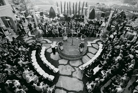 Black and white photo of round ceremony seating