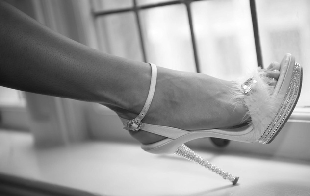 Black and white photo of bride's heel decorated with crystals