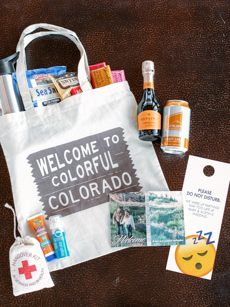 welcome bag for colorado wedding with snacks, emergency kit, do not disturb door tag