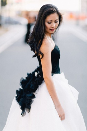 Bride in black and white Vera Wang wedding dress