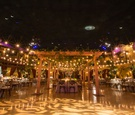 Indoor ballroom wedding reception at unique venue in Indiana light patio lights gobo projection