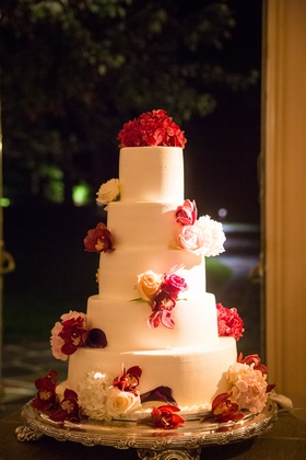 Wedding reception five layer white fondant wedding cake pink flowers white flowers hydrangea rose