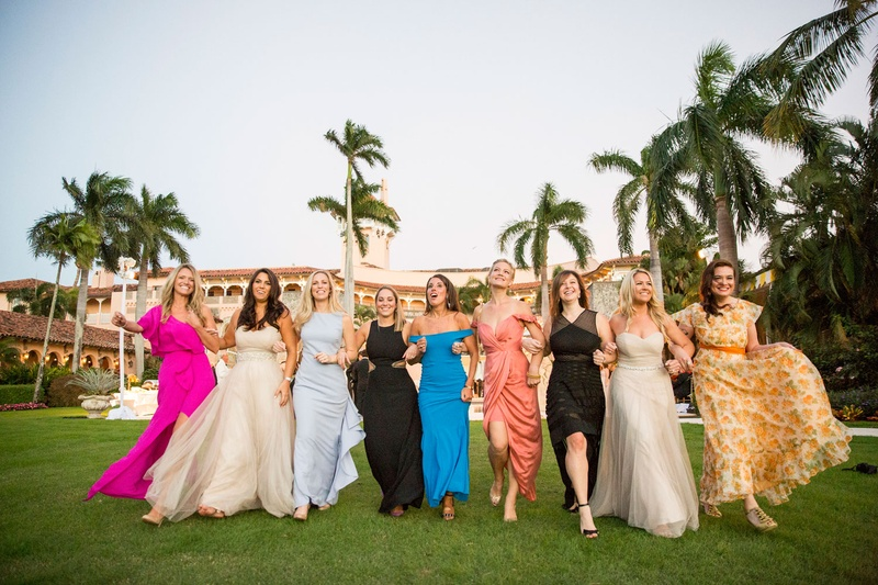 Wedding guests women in colorful dresses pink blue black white