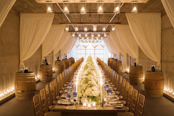 Rectangular table in vineyard barrel room