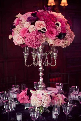 Silver candleholder with pink and purple wedding flowers