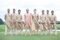 indian-american groom in sherwani, groomsmen in traditional outfits