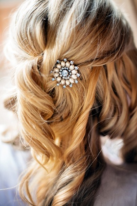 Bride with blonde hair and half up half down hairstyle with jewel headpiece
