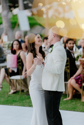 wedding reception white dance floor outdoor hawaii venue gold chairs white tuxedo jacket crepe dress