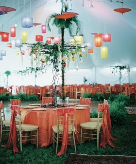 Reception tent with colorful tablecloths and lanterns