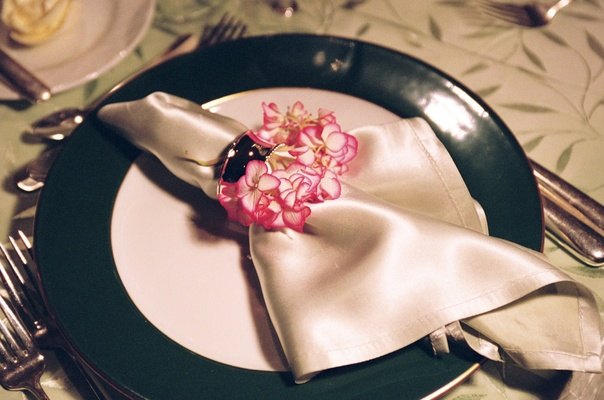 Ivory napkin with napkin ring decorated with pink and white hydrangea
