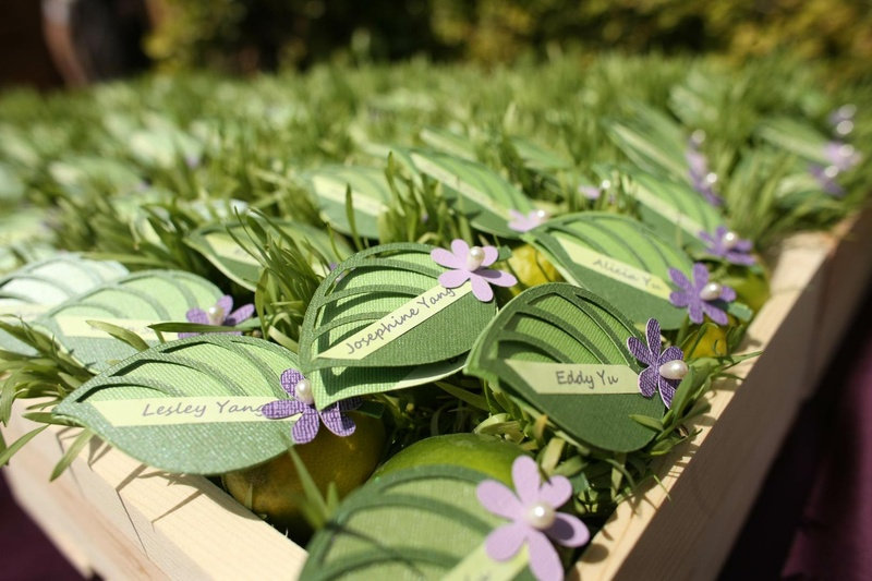 Escort cards in leaf design attached to fresh fruit