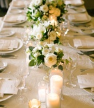 wedding reception long table white rose flower centerpiece greenery candles
