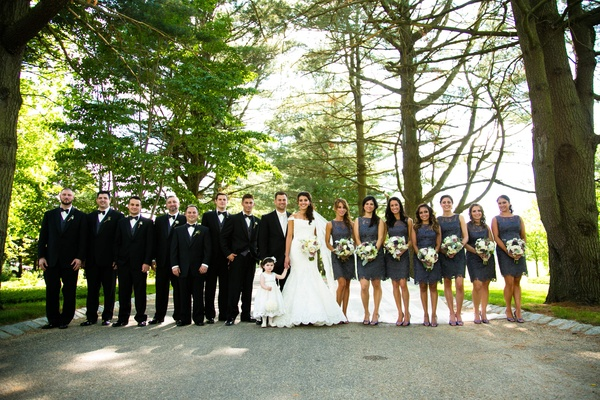 Bride and groom with bridesmaids and groomsmen under trees