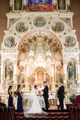 Bride and groom at altar st michael's church old town chicago catholic wedding ceremony ornate altar