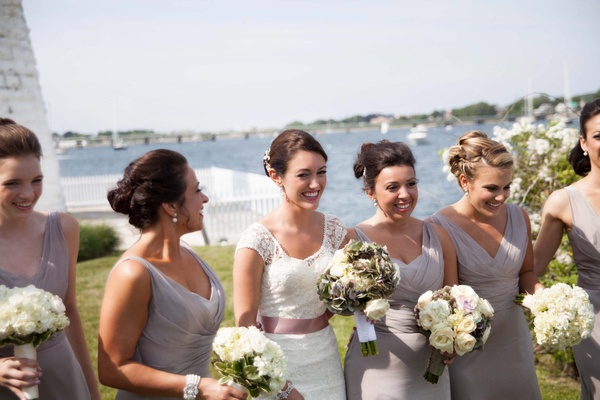 Bridesmaids' bouquets of white flowers