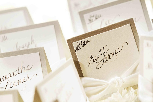 Seating cards with border and hand calligraphy